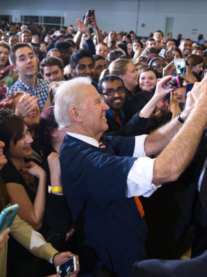 Joe takes a selfie with students.