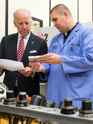Joe Biden speaks with a worker