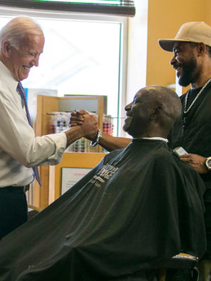 Joe Biden shaking hands at barber shop