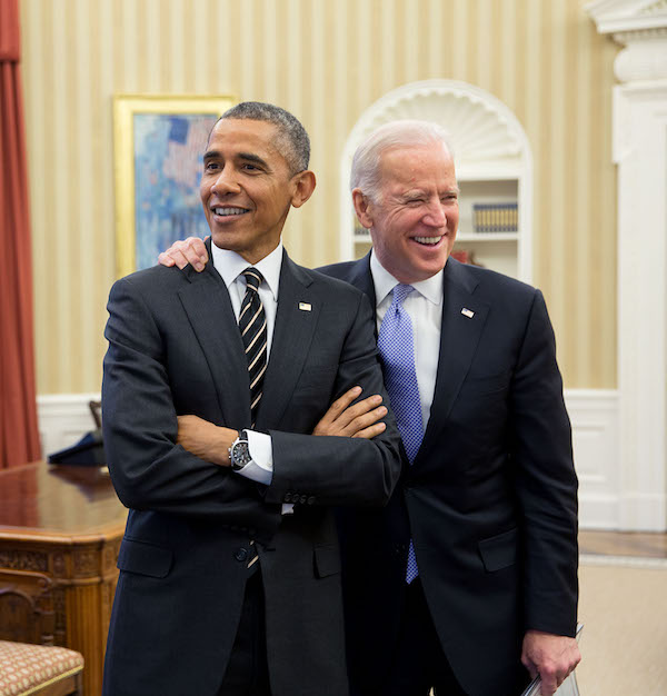 VP Biden and President Obama smiling in the Oval Office.