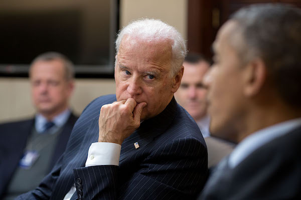 VP Biden in a meeting with President Obama and other staff.