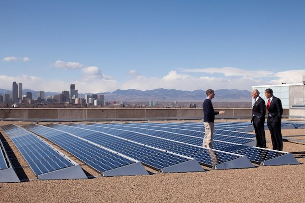VP Biden and President Obama survey a field of solar panels.