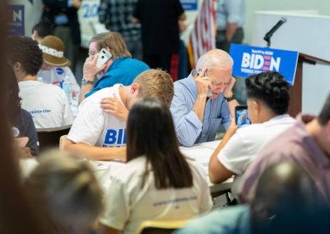 Joe Biden sits with campaign volunteers and makes calls to supporters