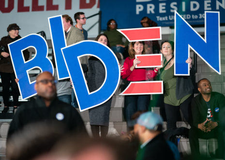 Supporters hold up a sign spelling out BIDEN.