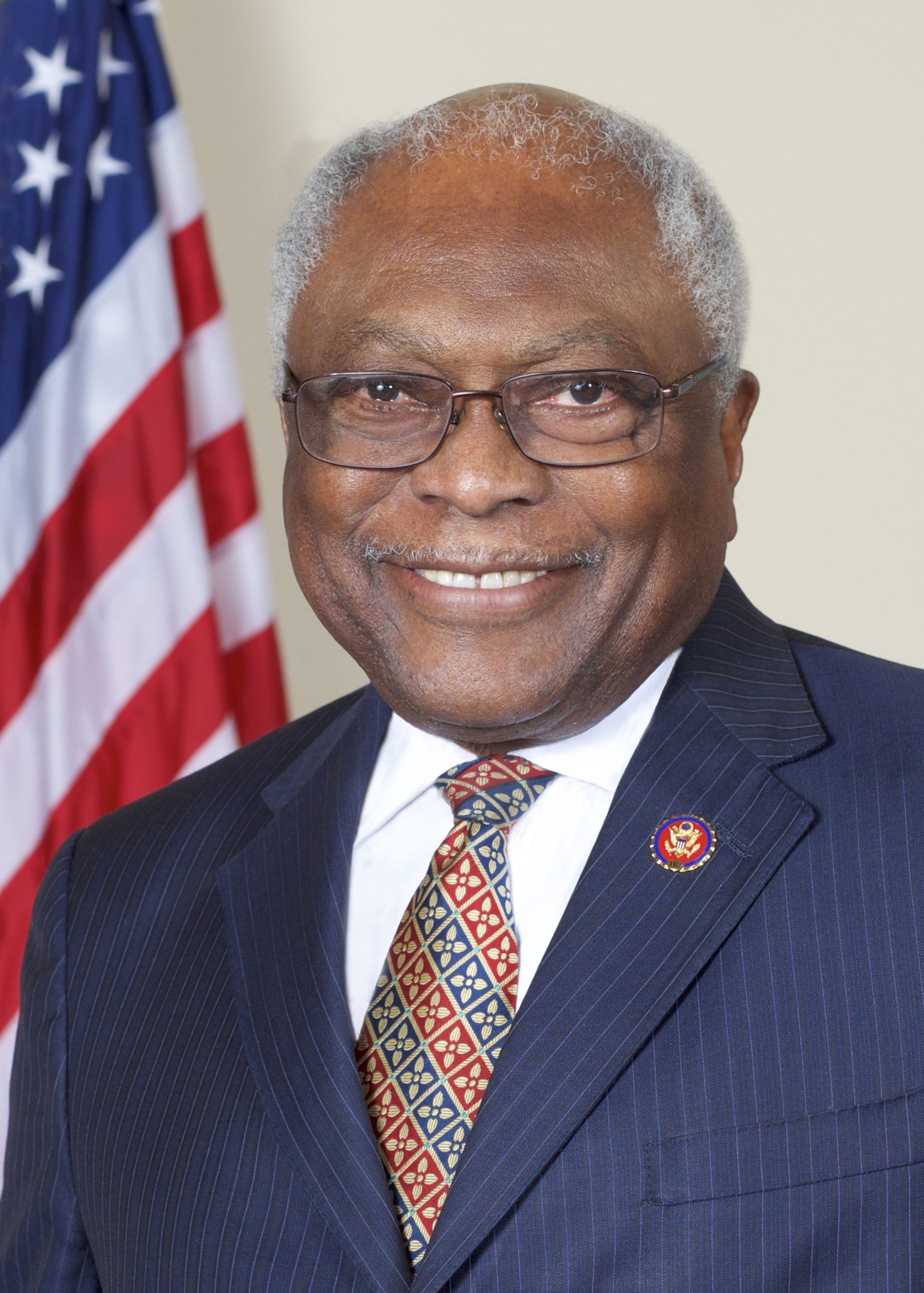 A portrait of Jim Clyburn in front of an American flag