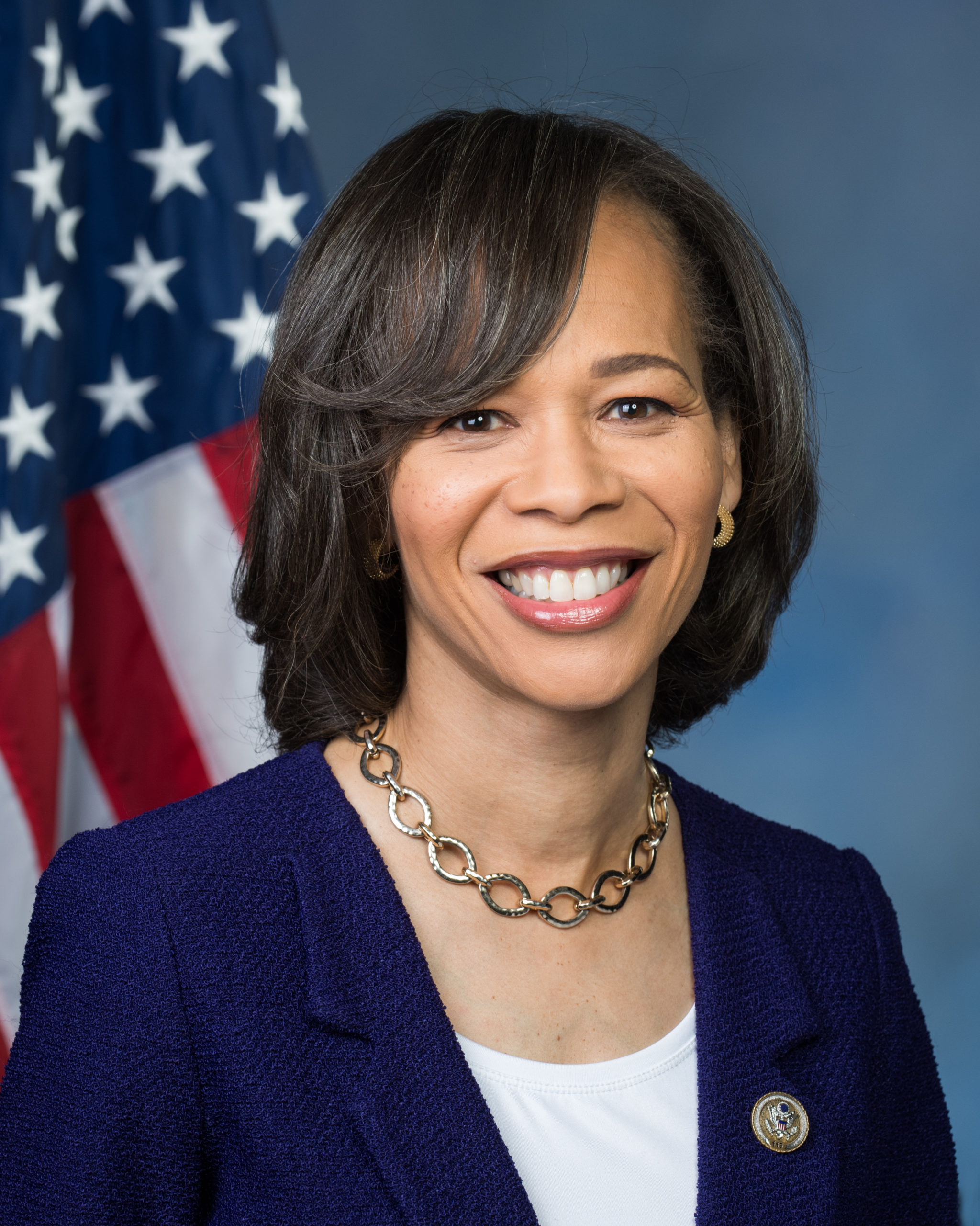 A portrait of Lisa Blunt Rochester in front of an American flag