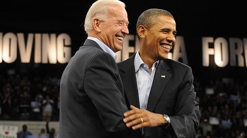 Obama and Biden embrace each other on stage