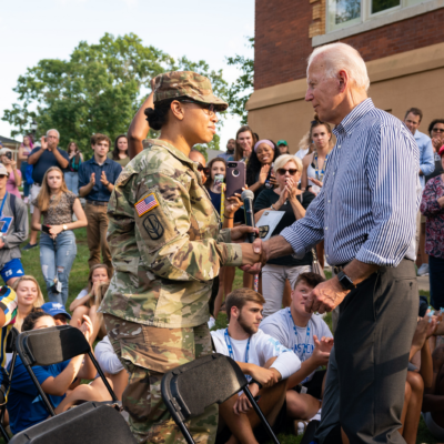 Joe Biden shakes hands with an American in a military uniform