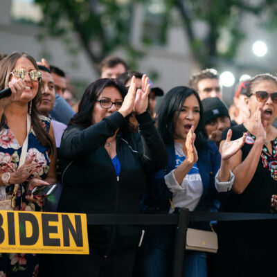 Latinx supporters of Joe Biden at a campaign rally