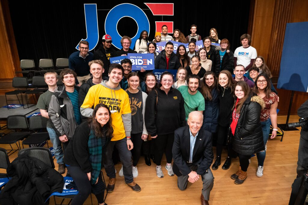 Joe Biden posing with a group of young people