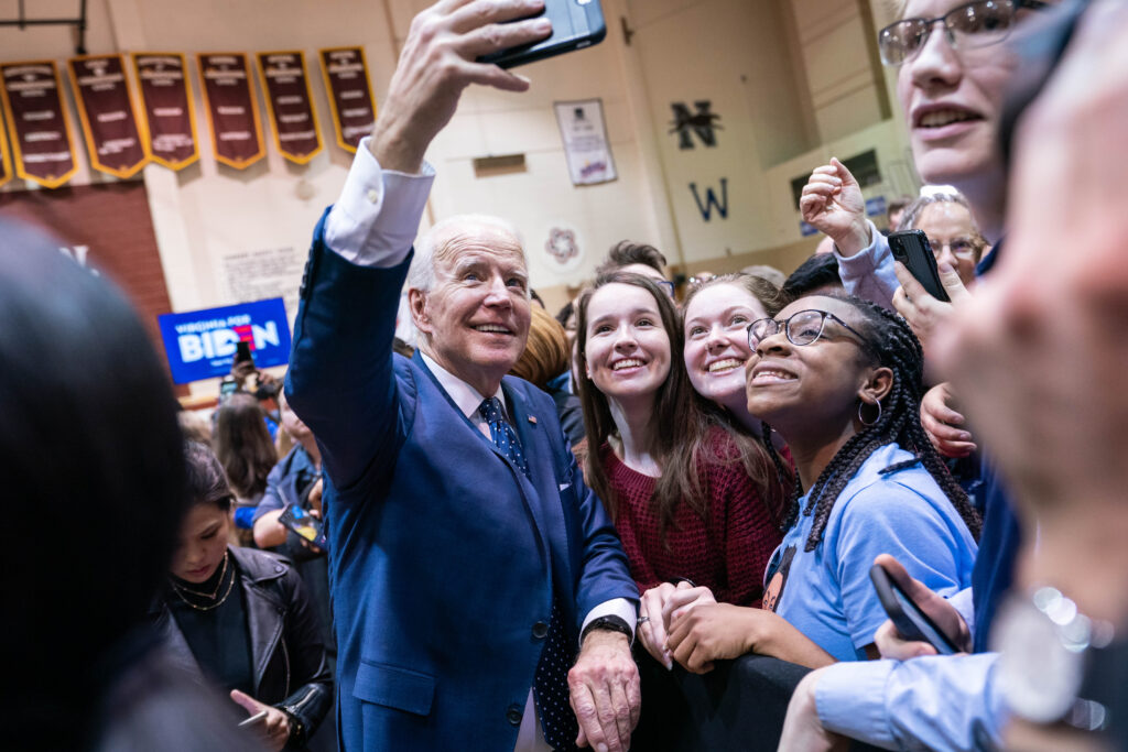 Joe Biden takes a selfie picture with three young women